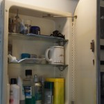 Dingy ugly medicine cabinet