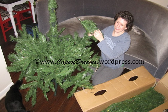 Assembling a fake Christmas tree