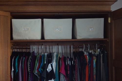 Canvas baskets used as drawers in wardrobe