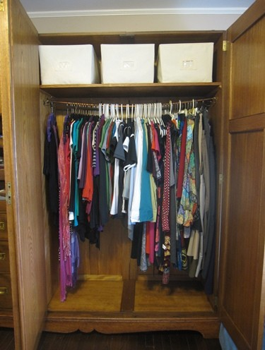 Bowed clothes rod in wardrobe