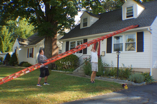 Putting a 32' ladder on the roof