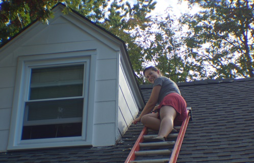 Scraping paint off dormer