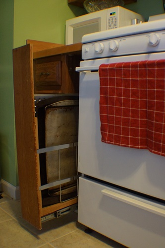 Narrow pull out drawers beside stove