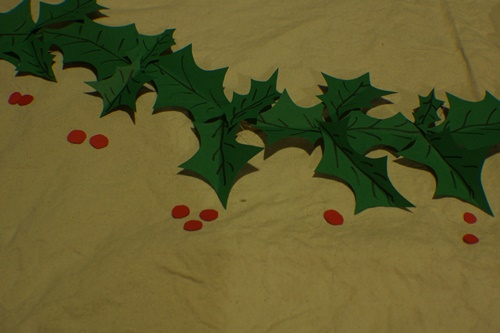 Laying out the leaves and berries for DIY Holly Garland