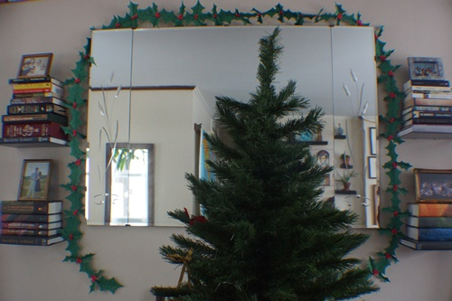 DIY Holly Garland draped over mirror