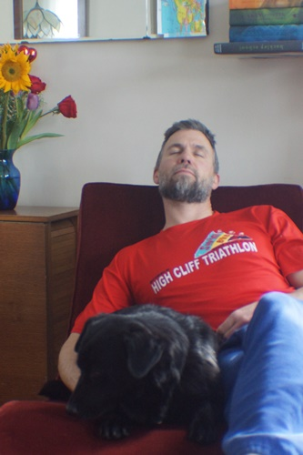Man and dog on chaise lounge