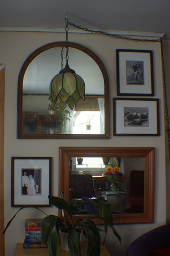 Gallery wall with mirrors and pictures