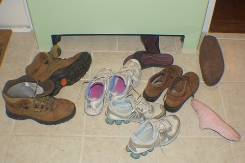 Mess Of Shoes In The Kitchen