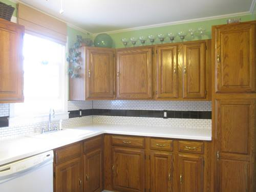 Caulking the kitchen cape of dreams for Caulking kitchen cabinets