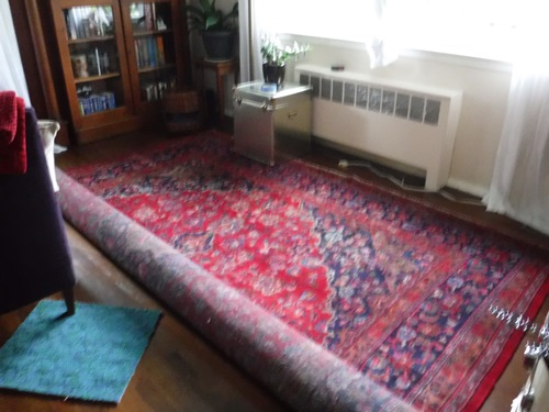 Moving furniture and a rug in the living room