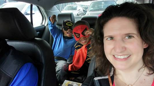 Batman and Spiderman in the car